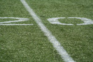 photo of the 20 yard line of a football field